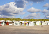 View at Dutch beach houses with cloudy sky — Stock Photo