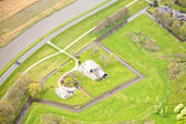 View at typical Dutch farm from above, The Netherlands — Stock Photo