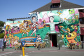 BEVERWIJK, THE NETHERLANDS - JUNE 11, 2014: Colorful street wall painting of Dutch soccer players and coach in Beverwijk, The Netherlands on June 11, 2014. This painting supports the participation of  — Stock Photo