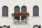 Balcony with geraniums — Stock Photo