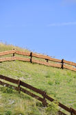 Wooden fence in a hill — Stock fotografie