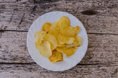 Plate with potato chips — Stock Photo