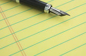 Fountain pen on legal pad — Stock Photo