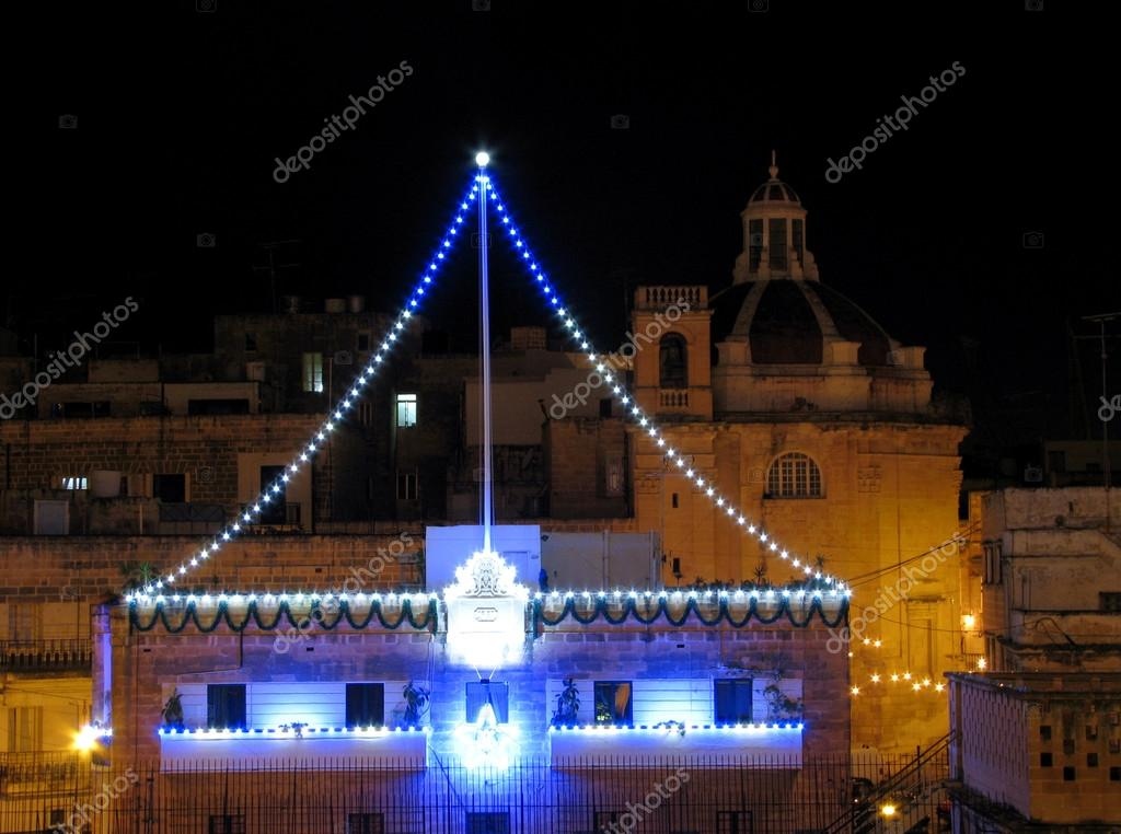 Some of the decorative lights on rooftops for the occassion of the feast of The Immaculate Conception in Cospicua, Malta.  Stock Photo #17337143
