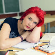 Redhead girl doing lessons - Stock Photo