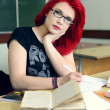 Stock Photo: Redhead girl doing lessons