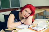 Redhead girl doing lessons — Stock Photo