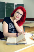 Redhead girl doing lessons — Foto de Stock