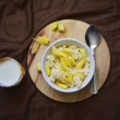 Stock Photo: Rice porrige with mango and glass of milk