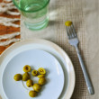 Stock Photo: Olives and glass of water