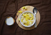 Rice porrige with mango and glass of milk — Foto de Stock