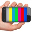 Hand holding mobile smart phone with tv test pattern screen. — Stock Photo #13818303