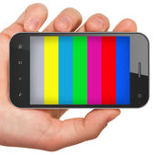 Hand holding mobile smart phone with tv test pattern screen. — Stock Photo