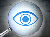 Magnifying optical glass with eye icon on digital background — Stock Photo