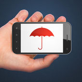 Hand holding smartphone with Umbrella on display. Generic mobile — Foto de Stock