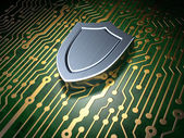 Security concept: circuit board with shield icon — Stock Photo