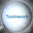 Magnifying optical glass with words Teamwork on digital backgrou - Stockfoto