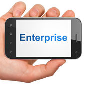 Hand holding smartphone with word Enterprise on display. Generic — Stock Photo
