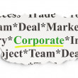 Stock Photo: Torn newspaper with words Corporate on background