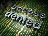 Security concept: circuit board with word access denied — Stock Photo