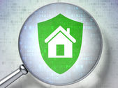 Security concept: optical glass with Shield icon — Stock Photo
