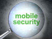 Safety concept: optical glass with words Mobile Security — Stock Photo