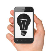 Business concept: smartphone with Light Bulb. — Stock Photo