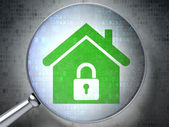 Security concept: optical glass with Home icon — Stock Photo