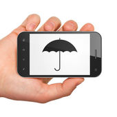 Privacy concept: smartphone with Umbrella. — Stok fotoğraf