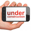 Royalty-Free Stock Photo: Web design SEO concept: smartphone with Under Construction