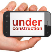 Web design SEO concept: smartphone with Under Construction — Foto de Stock