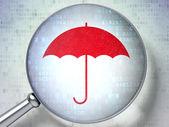 Protection concept: optical glass with Umbrella icon — Stock Photo