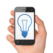 Finance concept: smartphone with Light Bulb. — Stock Photo