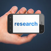 Marketing concept: smartphone with Research — Foto de Stock