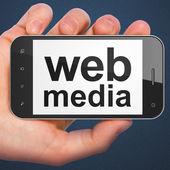 SEO web development concept: smartphone with Web Media — Stock Photo