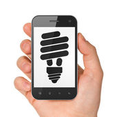 Business concept: smartphone with Energy Saving Lamp. — Stock Photo