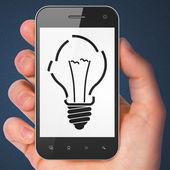 Business concept: smartphone with Light Bulb. — ストック写真