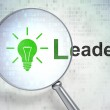 """Finance concept: optical glass with Light Bulb icon and """"Leader"""" — Stock Photo"""