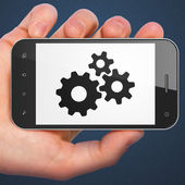 Advertising concept: smartphone with Gears. — Stock Photo