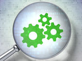 Marketing concept: optical glass with Gears icon — Stockfoto