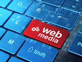 Web design concept: Gears and Web Media on computer keyboard — Stock Photo