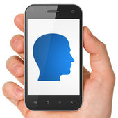 Information concept: Head on smartphone — Stock Photo