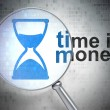 Time concept: Hourglass and Time is Money with optical glass - Foto de Stock