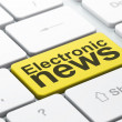 News concept: Electronic News on computer keyboard - Stock Photo