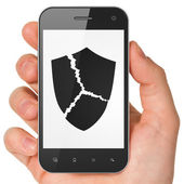 Security concept: Broken Shield on smartphone — Stockfoto