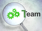 Business concept: Gears and Team with optical glass on digital b — Stock Photo