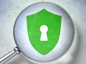 Protection concept: Shield With Keyhole with optical glass on d — Stock Photo