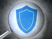 Safety concept: Shield with optical glass on digital background — Stockfoto