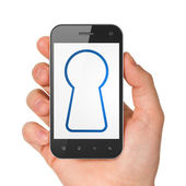 Information concept: Keyhole on smartphone — Stock Photo