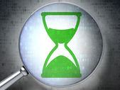 Timeline concept: Hourglass with optical glass on digital backg — Stock Photo